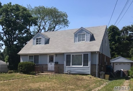 Well Maintained Wideline Cape In West Farmingdale, Opposite The Bethpage Preserve. Offers 4 Bedroom, Full Bath, Hdwd.Floors Thruout.Newer Heating System And Hot Water Heater, Gas For H/W & Cooking. Mostly Andersen Windows, Vinyl Siding, 1.5 Brick Garage, Finished Basement, Oversized Property, 1.5 Garage. 150 Amp Electric Whole House Is 1/2 Brick Exterior.Finished Basement. Ovsz.Property. Taxes Never Grieved