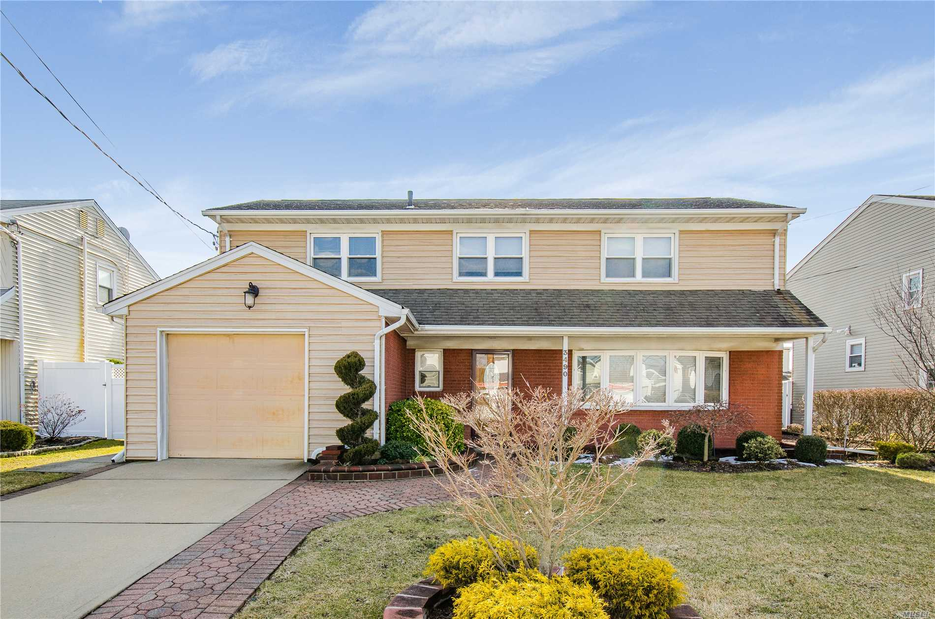 Beautiful Splanch, Mid Block, 7 Year Old Roof, Siding, Windows And Gas Burner, Cac, Finished Basement With Ceramic Tile Floor. 1.5 Car Garage. Beautifully Landscaped. Flood Zone X.
