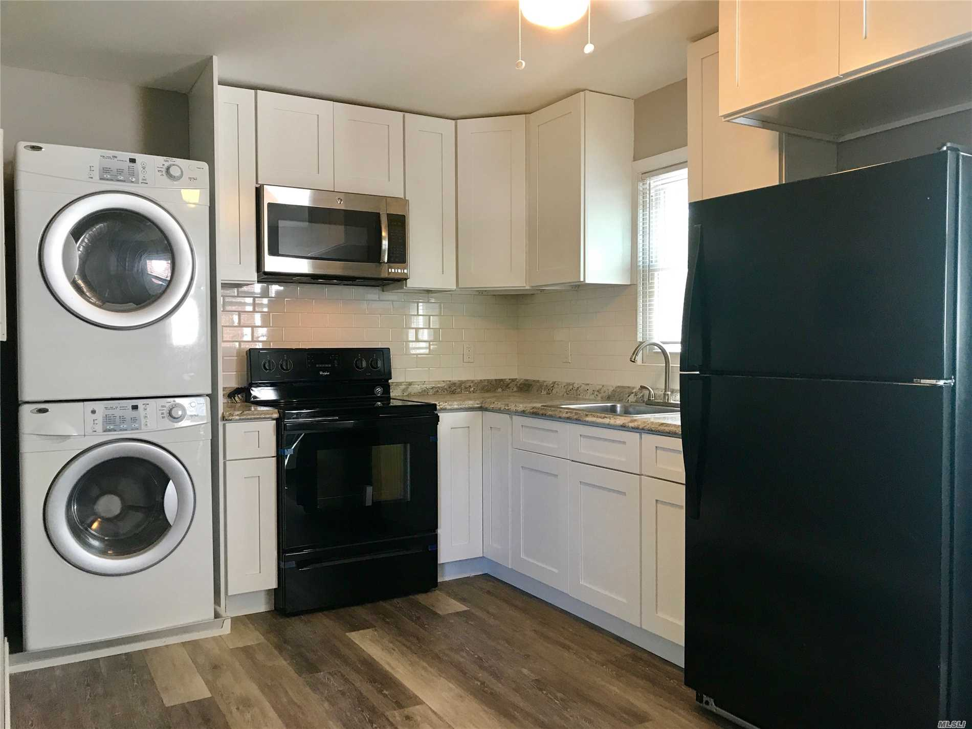 Beautiful Redone 2 Bedroom 1 Bath Apartment. Updated Eat In Kitchen With Updated Appliances/Counters And White Shaker Cabinets. Plus A Washer And Dryer Included. Updated Designer Bathroom With All Updated Fixtures. Plus 2 Ac's In The Wall. Absolutely No Pets Or Smoking (Also No Smoking On Premises Of House)
