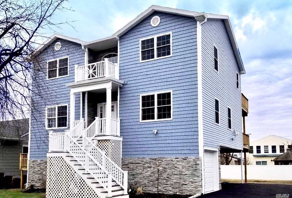 Classic Look With A Modern Touch. New Construction Built To And Beyond Fema Standards! Nestled In Heart Of Freeport, Moments Away From The Famous Nautical Mile. This Beautifully Designed Home Features 4 Bedrooms & 2 1/2 Bathrooms Including A Master Suite Complete With A Private Balcony. Designer Finishes Throughout The Home-Open Concept Floor Plan, Chef's Kitchen & Dining Room With Access To A 2nd Balcony, Gas Fireplace & 3 Car Garage. Quality, Style And Functionality Makes This Home A Must See!