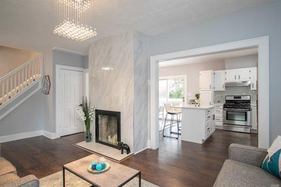 Fully Remodeled, This Gorgeous Home Is Ready For You To Make It Your Own! Fabulous Living Room With A Stunning Fireplace, A Contemporary Dining Space With A Modern Kitchen, Spacious Bedrooms, Newly Renovated Exterior And A Large Private Driveway With A Detached Garage - This Home Has It All! Central Location - Walking Distance To Lirr And Merrick Rd And Grand Ave And So Much More! A Must See!
