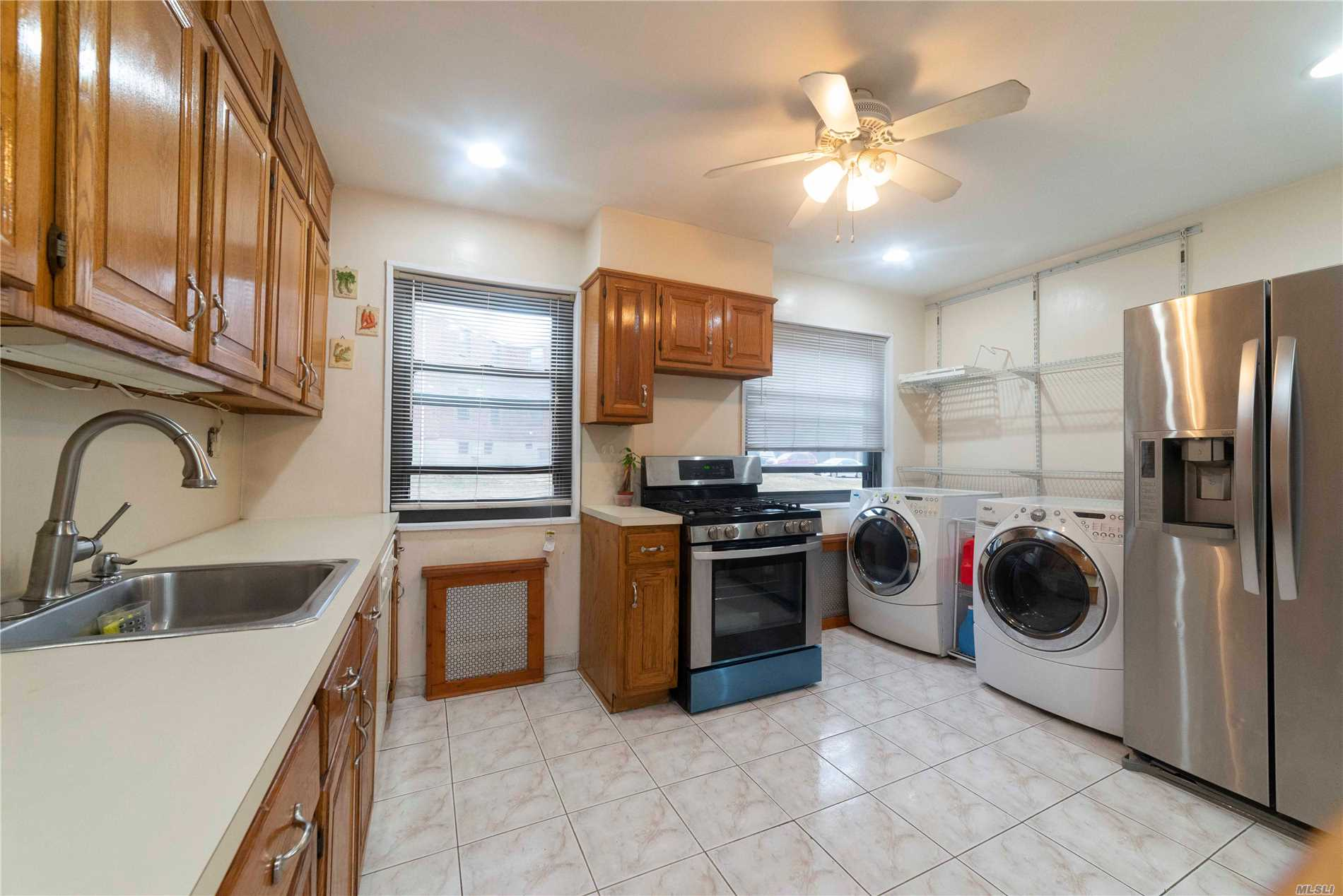 Bright Corner Unit- 1 Fl, Updated Kit, Bath.Wash/Dryer In Kit, New Ss Stove, Nice Sized Rooms, Includes 2 Wall Mount Flat Screen Tv's.Lr: 46 W Sound System, Br 32. 1 Ac In Lr, Hi-Hats Throughout.Maint Inclu Elec, Heat, Gas, Water, Sewer, Taxes. Easy Street Pkg. Quiet Area. One Block To Ps 209 And Jhs 194.  Income Requirements: $44, 800 Plus 12 Months Mortgage/Debt. No Dogs, 2 Cats Ok, No Subletting. X Buses To Nyc (Qm2 & Qm20) And Q16 All On The Corner. Major Highways Nearby And Close To Shopping.