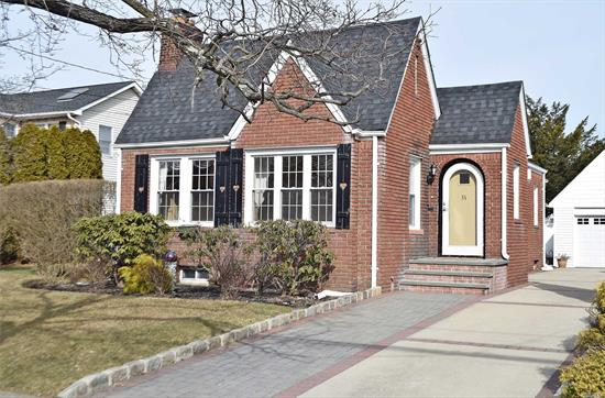Unique One Of A Kind Picture Perfect And Charming Brick English Cottage Home With Large Private Yard And Located On Tree Lined Street in School District 13. Great First Home Or To Downsize, Also Offers Ample Property for future Expansion. Truly a special home and a must see.