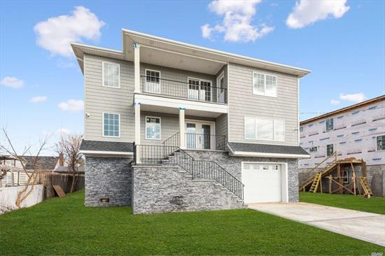 Brand New 3 Story House W/Beautiful Finishes.This Energy Efficient Home Is A Must See! 5 Large Bdrms, Each With A Full Bath & High End Ceiling Fan. Mstr Bdrm Has A W/I Closet & Balcony.Tremendous Kitchen W/Center Island & Brand Name Appliances. Also Features:Wood Flrs, Crown Molding, Cac, Gas Heat, Interior Smart Sprinkler System, Energy Eff Windows, Heating System& Hot Water Heater, Soft Close Drawers& Cabinets, Fema Compliant.Very Quiet St. A Few Blocks From Inwood Park & A Short Distance To LIRR& Jfk