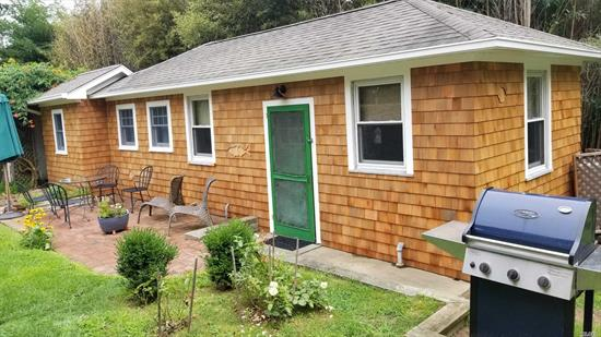 Just Two Blocks To A Sandy Bay Beach, This Charming Cedar Shake Cottage Is The Perfect Summer Getaway. The Bedroom Has A Queen Size Bed, The Bathroom Is All New. The Living Room Has A Futon Sofa, And The Spacious Eat-In Kitchen Features Full Size Appliances. A Furnished Brick Patio Runs The Length Of The Cottage, Complete With Gas Grill. New Suffolk Is A Historic Maritime Hamlet At The Heart Of The North Fork, With Two Restaurants And Great Beaches. Moments From Renowned Wineries And Farms.