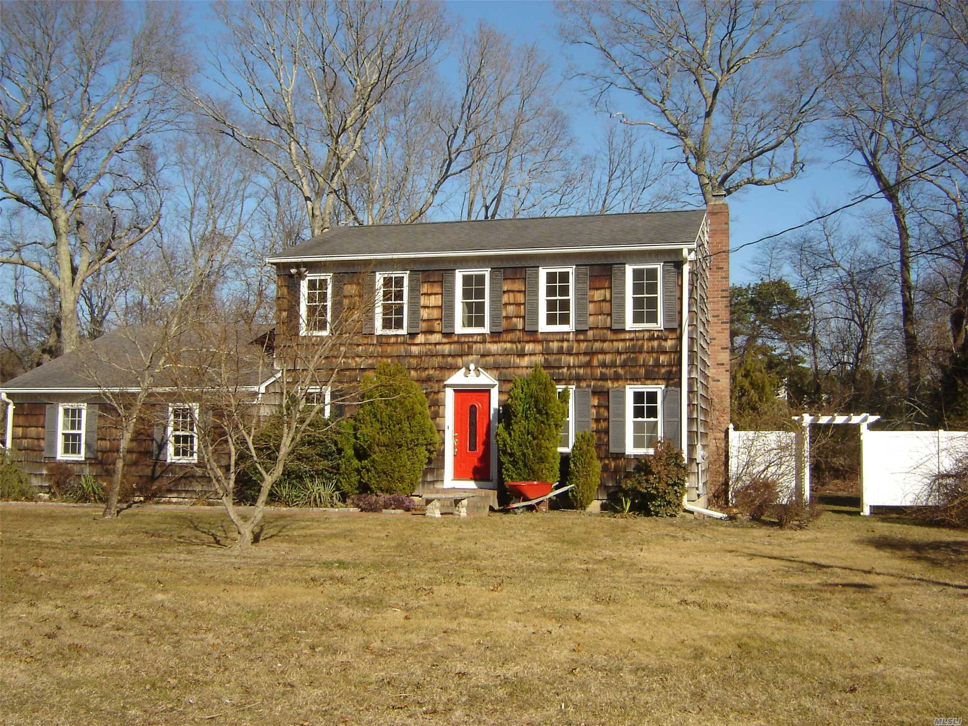 Nicely Kept Colonial In Desirable Wooded Development. Shoreham-Wading River Schools, Hardwood Floors, Updated Kitchen, Freshly Painted Interior, Den W/Wood Burning Stove, Finished Basement W/Playroom And Separate Office Or Study Room. Large Private Yard With Paver Patio And In-Ground Sprinklers.Cedar Shakes On Entire Exterior. Newer 30 Year Architectural Roof.