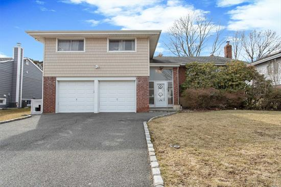 Huge Split With Plenty Of Room For Extended Family. Brand New, Beautiful And Large Eik With Tremendous Peninsula With Lots Of Seating. Open To Large Dining Room. Oversized Laundry Room. Master Bedroom With Full Bath And Wic. Lower Level Family Room With Full Wall Brick Fireplace. Possible Mother Daughter.
