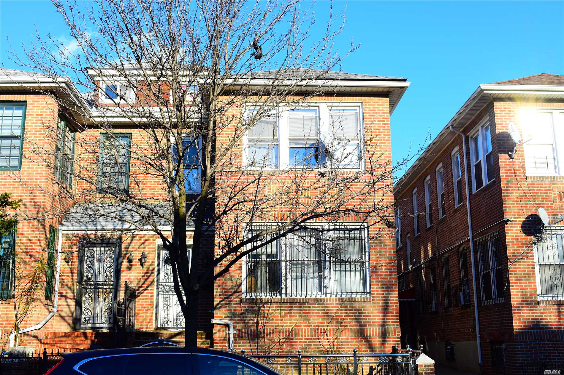 A Beautiful And Spacious Two-Family Home In Jackson Heights! Home Is Currently Configured With Three Bedrooms, Full Bath, Eat-In Kitchen, Living Room And Sunroom On The 1st Floor. 2nd Floor Has Four Bedrooms, Full Bath, Kitchen, And Dining Area. Rooms Are Filled With Natural Light And The High Ceilings Give This Home An Open And Airy Esthetic. Finished Full Basement And Attic Too! 20X57 Lot Size, With Approximately 2300 Interior Square Footage. Brand New Roof Installed Just Over A Year Ago! Deta
