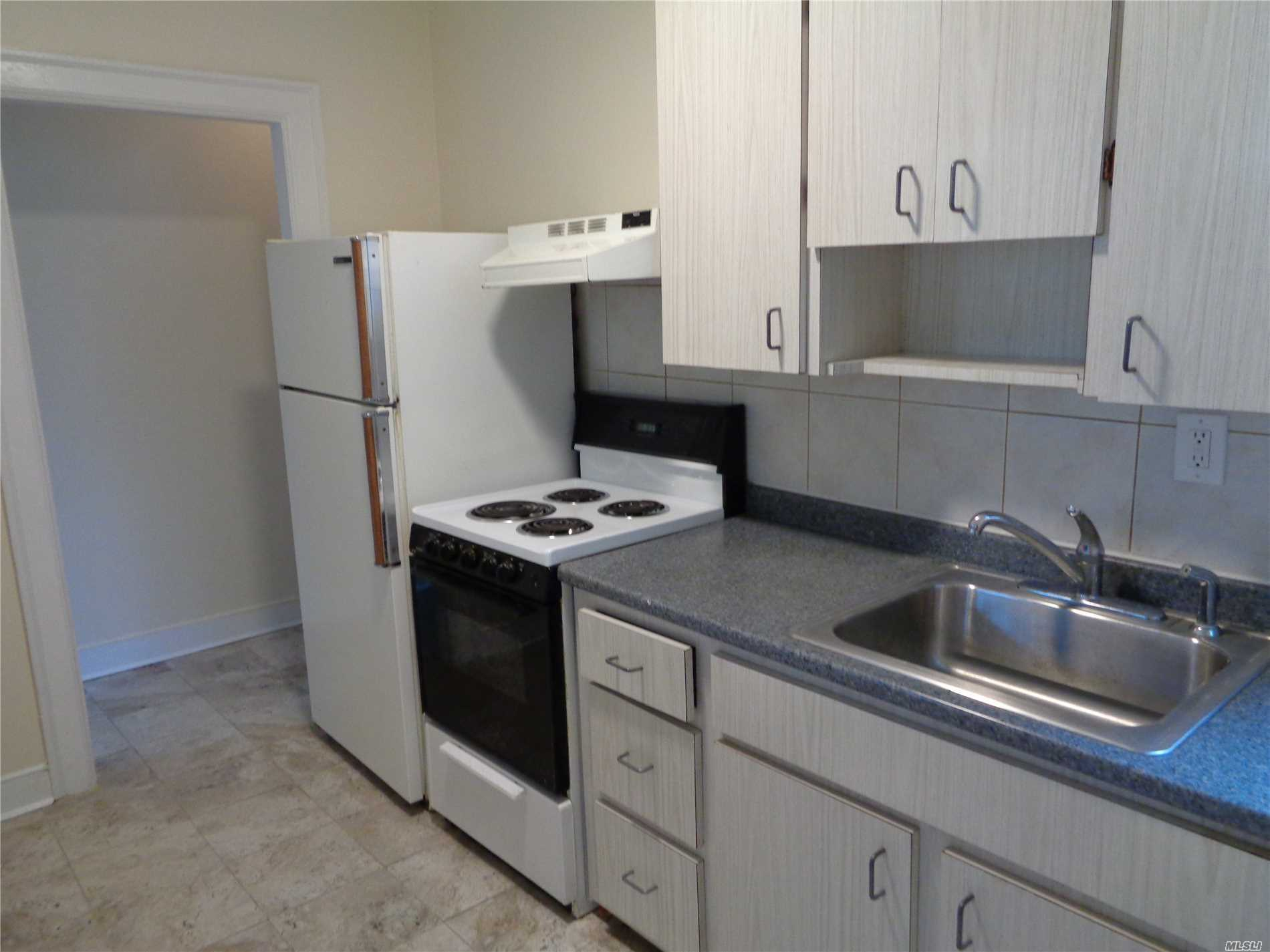 Location! Location! Location! 2nd Floor Apartment In Mixed-Use Building. This Mint 1-Bedroom Apartment Features Eat-In-Kitchen, Lr/Dr, Full Bath And Hardwood Floors. Stove Is Electric. Near To Shopping, Lirr And Entertainment. 1 Parking Spot. Please No Use Of Candles! A Must See!