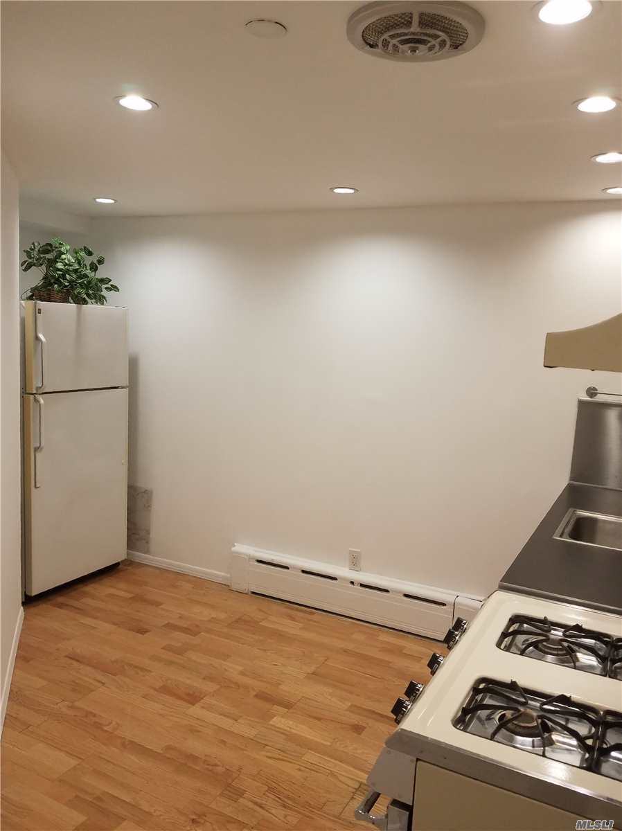 Newly Updated Bright Legal Lower Level Forest Hills Studio For Rent Conveniently Located Around The Corner From 67th Ave Subway Station With Hard Wood Flooring, Updated Eat-In-Kitchen And Bathroom, Brand New A/C Unit, Recessed Lighting And Large Windows.