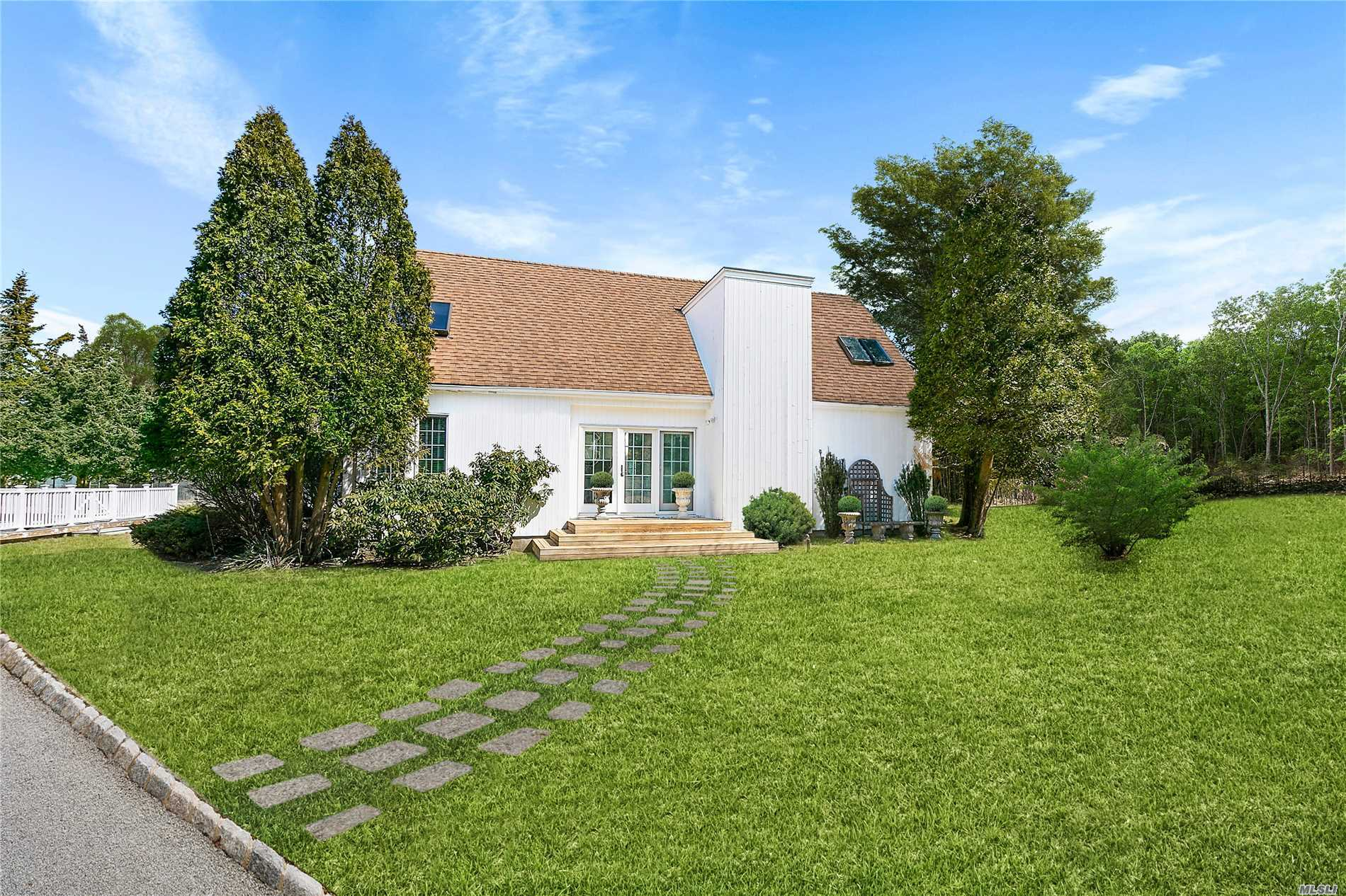 Beautifully Appointed 3 Bedroom Contemporary On A Private 1.15 Acre Flag Lot. Pool, Tennis, Fireplace, Finished Lower Level And More For The Perfect Hamptons Escape!