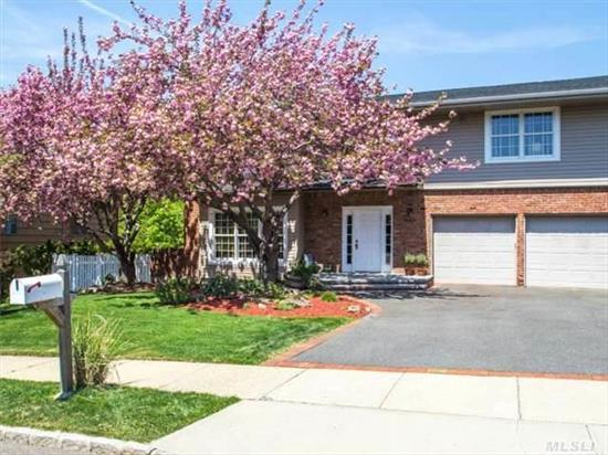 Beautiful Side Hall Colonial On Perfect Mid-Block Location. This 5 Bdrm, 2.5 Bth Home Features Wood Flrs & Spacious Rms. French Doors To Deck From Fam Rm W/Brick Fpl And Skylts,  Gorgeous Eik, W Cstm Cabinets, Granite, & Stainless Hi-End Appl,  Lrge Mstr Bdrm Suite, 2nd Flr Lndry Rm. Fin Bsmt W/Play Rm, Storage & Pr. Huge Deck Overlooking Flat Property. Syosset Schools