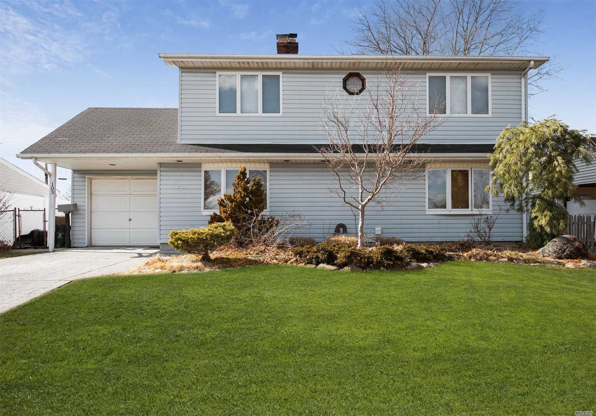 Location! Location! Location! This 4 Bedroom, 1.5 Bath Colonial In The Heart Of Levittown Features An Eat-In Kitchen, Formal Dining Room, And An Expansive Great Room. The Oversized Garage Features Attic Storage And The Backyard Is Ideal For Entertaining And Play. This Well-Kept, Move-In Ready Home With Plenty Of Indoor And Outdoor Space Is Ready For You To Add Your Special Touch. Just Minutes From Everything And With A Major Tax Grievance On File, You Have To See It To Believe It.
