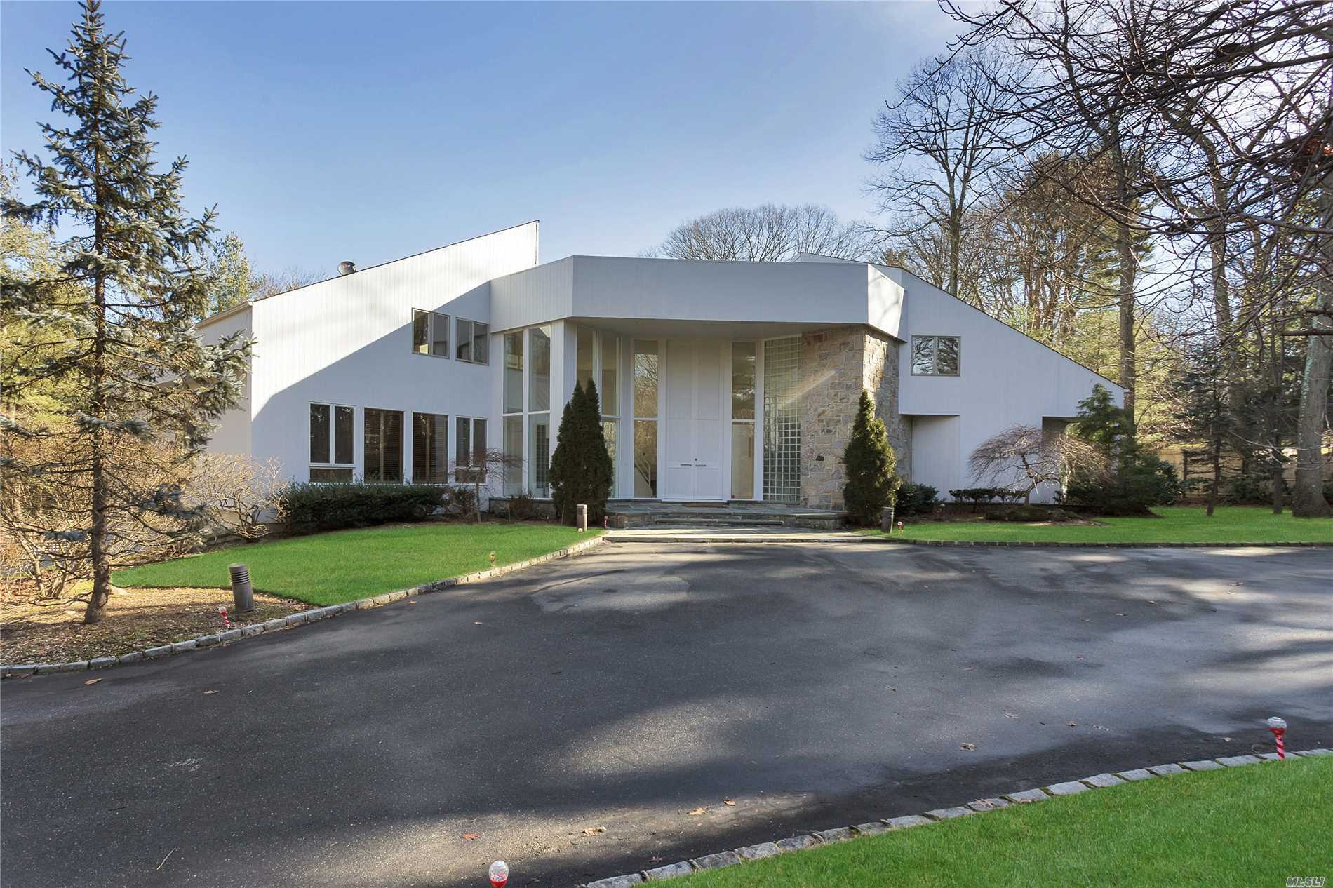 Muttontown. Majestic And Remarkable Contemporary In The Heart Of Muttontown. This Special 5-Bedroom, 4.55-Bath Home With Walls Of Glass Throughout Has A Bright And Airy Open Floorplan. With Natural Light Shining Through; Featuring High Ceilings Throughout, 2-Story Entry Foyer, Dining Room And Living Room, Incredible Chefs Kitchen, Master Bedroom Suite On The Main With Sliding Doors To Deck, Jacuzzi&Sauna, Indoor & Outdoor Inground Pool & Much More!