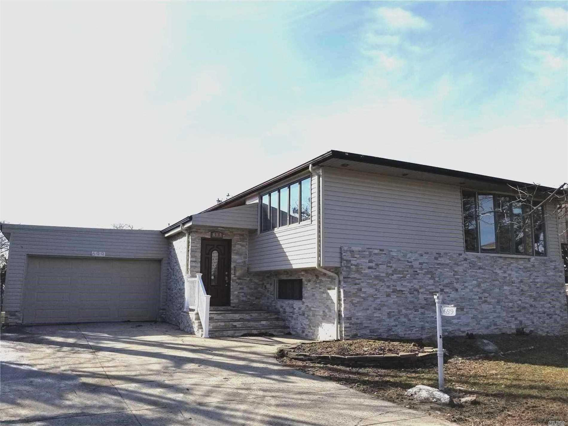 Wake Up To Water Views In This Newly, Completely Renovated House By The Water. New Open Concept Stylish Kitchen W. Double Sink, Granite, Never Been Used Ss Appl. New Bathroom With Double Sinks, + Master Suite W. Full Bath. Lower Level Has New Full Bath, Office, Large Family Room W. Fire Place, 2 Bedrooms, Walk In Closet, Much Storage, 2 Car Garage.