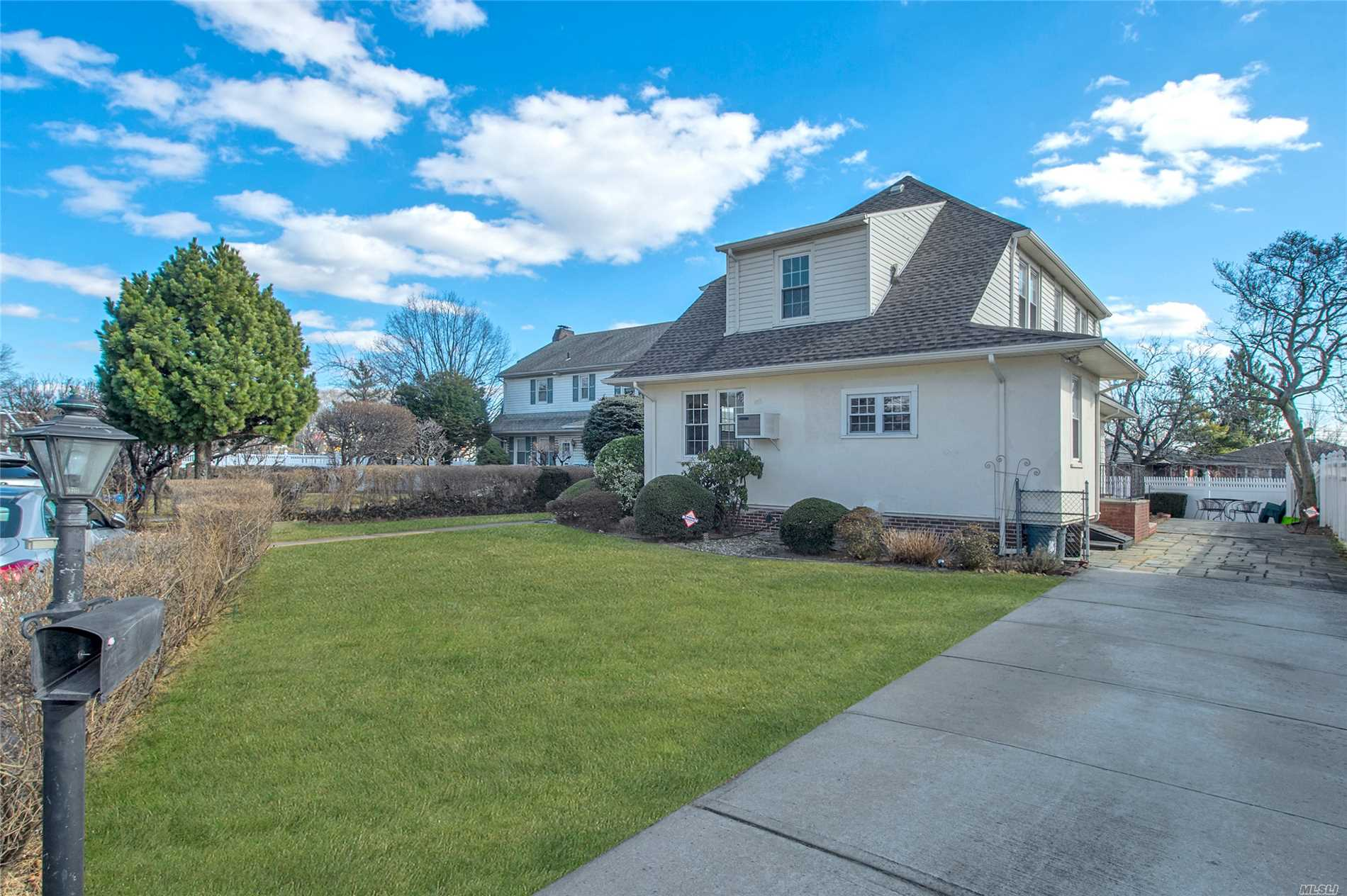 A Bright & Sunny Center Hall Colonial House ( 7685 Sqft Size Lot) In Beautiful Malba. It Features A Spacious Living Room W/Fire Place, Dinning Room, Open Kitchen With Cherry Cabinets W/Granite Counter Tops, Office/ Den And Bath In 1st Fl. 3 Bedrooms & 2 Full Baths On 2 Fl. Faces To East & South. Renovated The Roof, Floors, Kitchen, Baths & Fence 5 Years Ago. New Hot Water Tank. Hardwood Floor Throughout. Driveway Parking Available For 3 Vehicles. Close To Highway & Shopping Center.