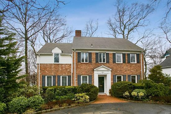 Circular Driveway Leads To This Stately Brick Center Hall Colonial. Very Lrg Lr, Skylit Cathedral Den, Formal Dining Rm, Eat In Kitchen And Bedroom Or Office. 2nd Floor There Are 4 Large Bedrooms And Two Baths. Full Walk Up Attic. Finished Walkout Basement With Great Den Or Playroom House Is In Pristine Condition. Extra's Galore.