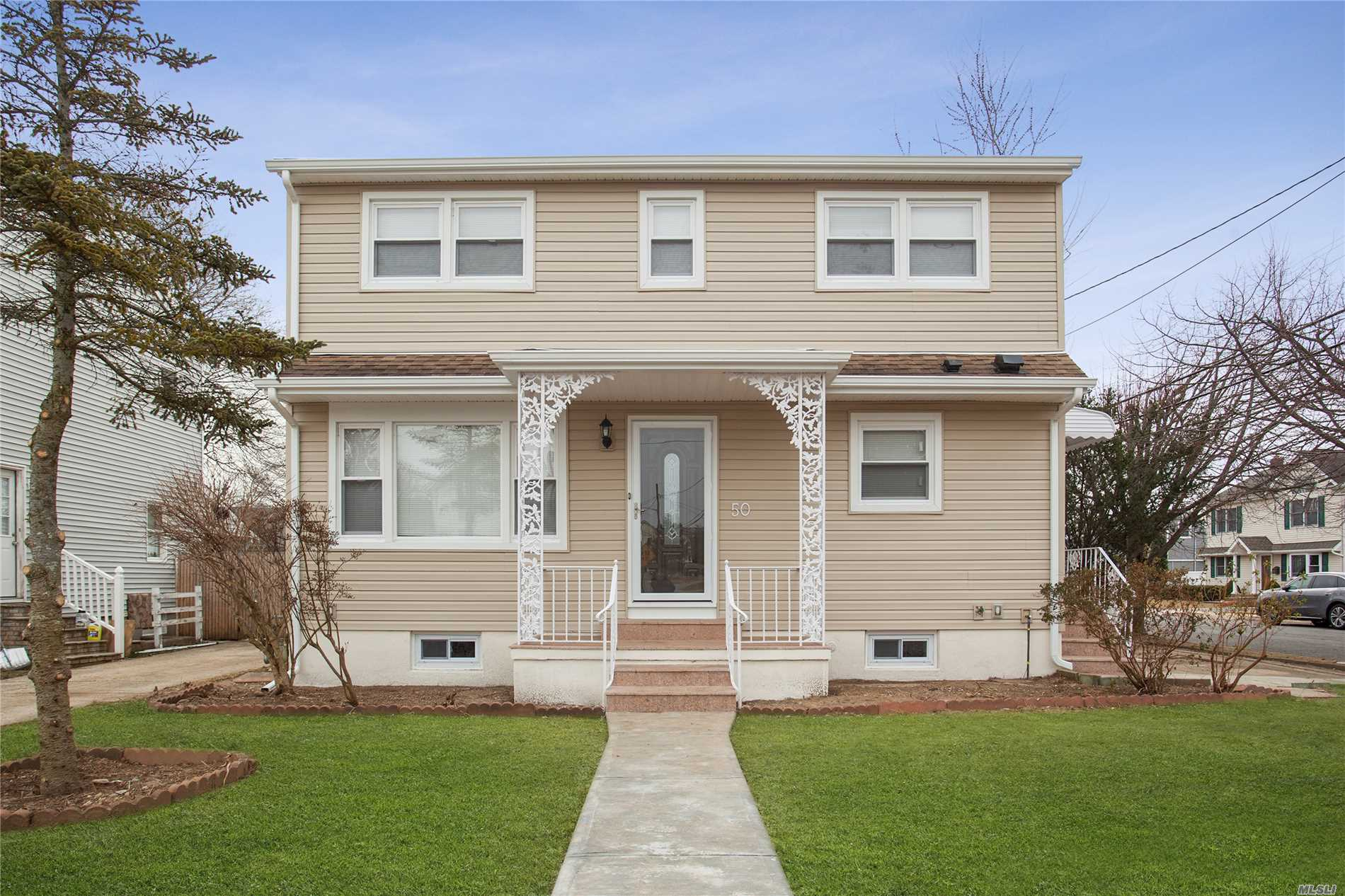 Impeccable Newly Renovated Colonial Home. First Fl Features A Beautiful Living Rm, Dining Room, Updated Kitchen With Stainless Steel Appliances, And A Master Bedroom Along With A Full Bathroom. Large Second Fl With 5 Spacious Bedrooms. Full Finished Basement With Full Bathroom And Separate Outside Entrance. Walking Distance To Lirr Station & Public Library. Highway Exit Only A Few Blocks Away.