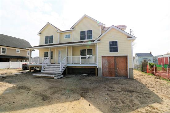 The house is almost completed. New pictures arriving soon! Bring Your Boat!! Brand New Elevated. Waterfront Colonial! Gourmet Kitchen W/ High End Stainless Steel Appliances! Open Concept Living! Harwood Floors! Master Bedroom W/ En Suite! 3 Additional Brs & Full Bath! Great Yard!