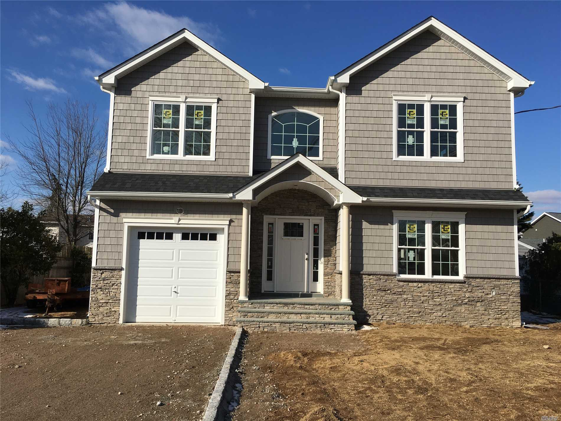 Exceptional Builder To Detail, Brand New Colonial, 4Br, 2.5Ba, Stunning 9' Ff Ceilings, Extra Wide Staircase, Lr, Formal Dr, Eik Granite Island, Half Bath W/Carrera Marble W/Ss Appliances, Den, W/Gas F/P, Magnificent Crown Molding & Wainscoting On F/F Leading Up To The 2nd Floor.Master Suite W/Tray Ceilings/Huge Full Ba With Shower Stall & Jacuzzi Tub.3 Nice Size Br, Full Granite Bath, 2nd Fl Laundry Room, 4 1/4' H/W Floors Throughout. Full Basement, 8'Ceilings, W/Ose, 8' Garage Dr, W/High Ceilings, Energy Star!