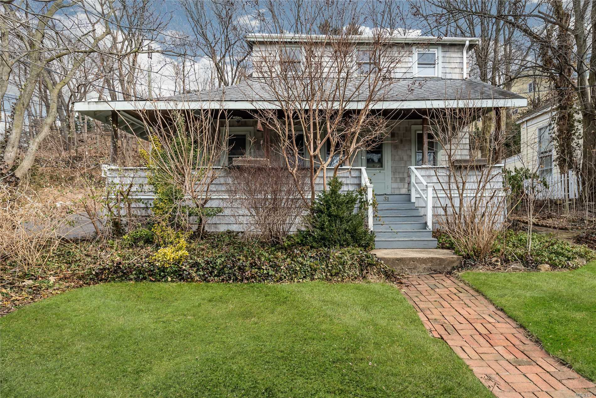 Charming Home In Historic Village Of Roslyn With Original Details with Views of Roslyn Pond... Needs TLC Living Room With Dining Area  Country Eik With Antique Chambers Stove, A Pot Belly Stove. 3 Bedrooms 1 Bath. Nice Backyard With Perennial Garden In The Summer.