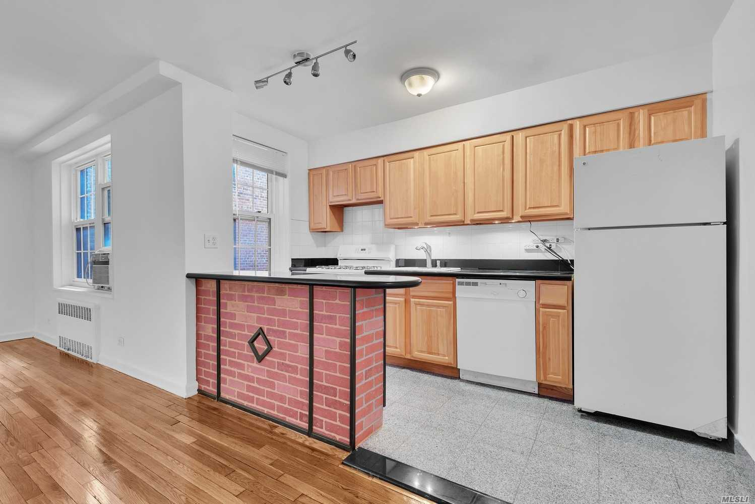 Pristine 2Br/1Ba In Close Proximity To F The Train. Nicely Polished Hardwood Floors, The Open Kitchen Features Granite Counter Tops, Dishwasher And A Breakfast Bar With Additional Storage. Windows In Every Room. Plenty Of Closets. Live In Super, Laundry In Building, Video Intercom, Wait List For Garage Parking.
