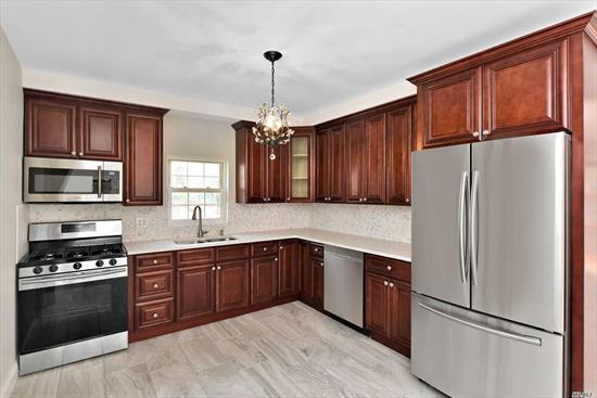 Beautiful Single Family Colonial Tastefully Renovated, Ground Fl-Living Rm Has Fireplace And Hardwood Floors. Dining Rm Opens To Large Deck & Back Yard. New Adorable Full Bath. Kitchen Is A Dream, With New Stainless Steel Appliances, Beautiful Countertops & Cabinets. Second Level Has 3 Generous Sized Bedrms With Full Size Closets & All New Full Bath With Jacuzzi Top.3rd Level Has Large Room For All Family Enjoyment Or Extra Bedroom. Laundry In Bsmnt. Det. 1Car Garage & Huge Driveway Fits 4 Cars.
