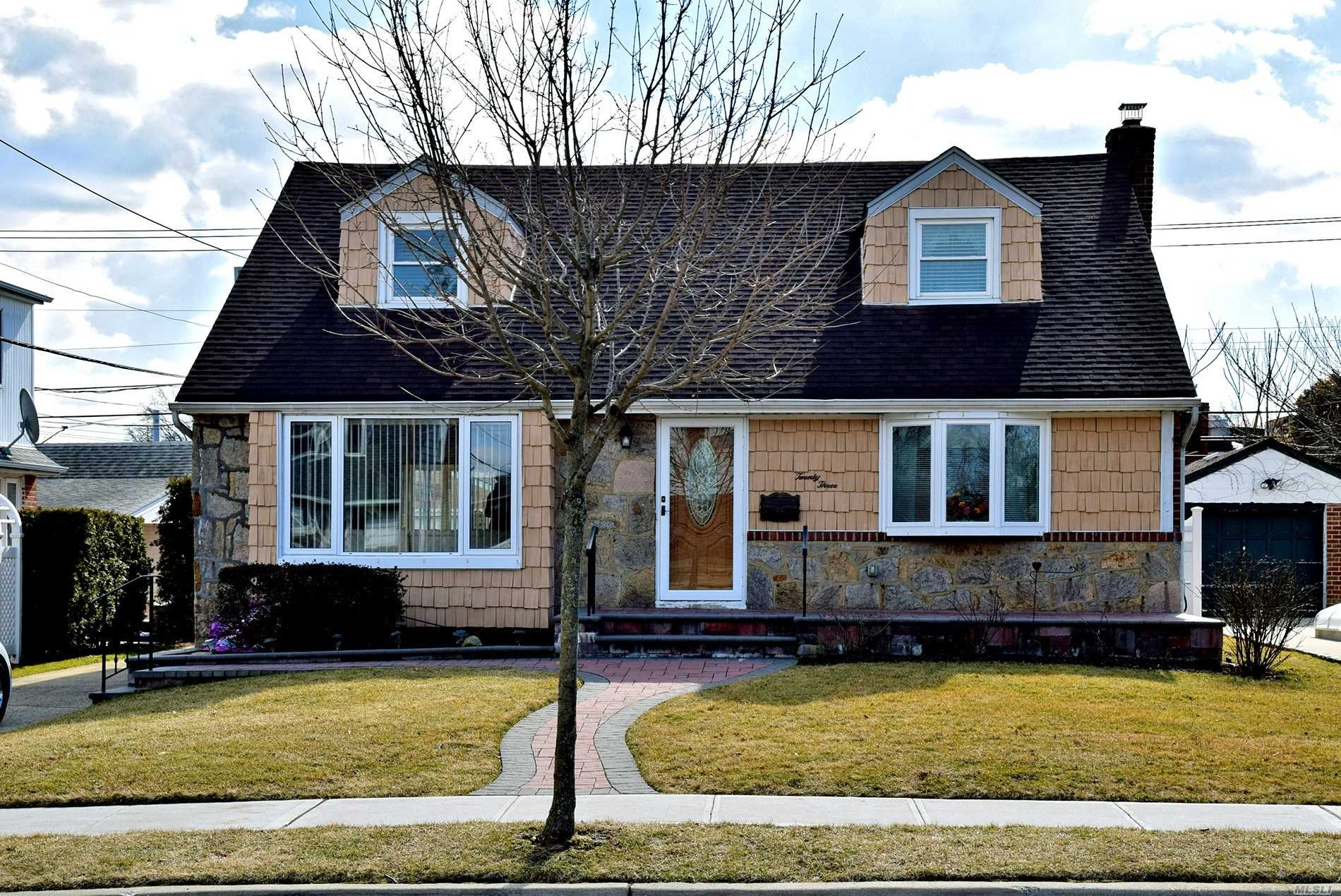 Spacious 4/6 Bedrooms Expanded Cape, Perfect For Mother / Daughter With Proper Permits, Freshly Painted, Wood Floors,  East Willston Schools, Convenient Location To Transportation , Shopping And Restaurants,