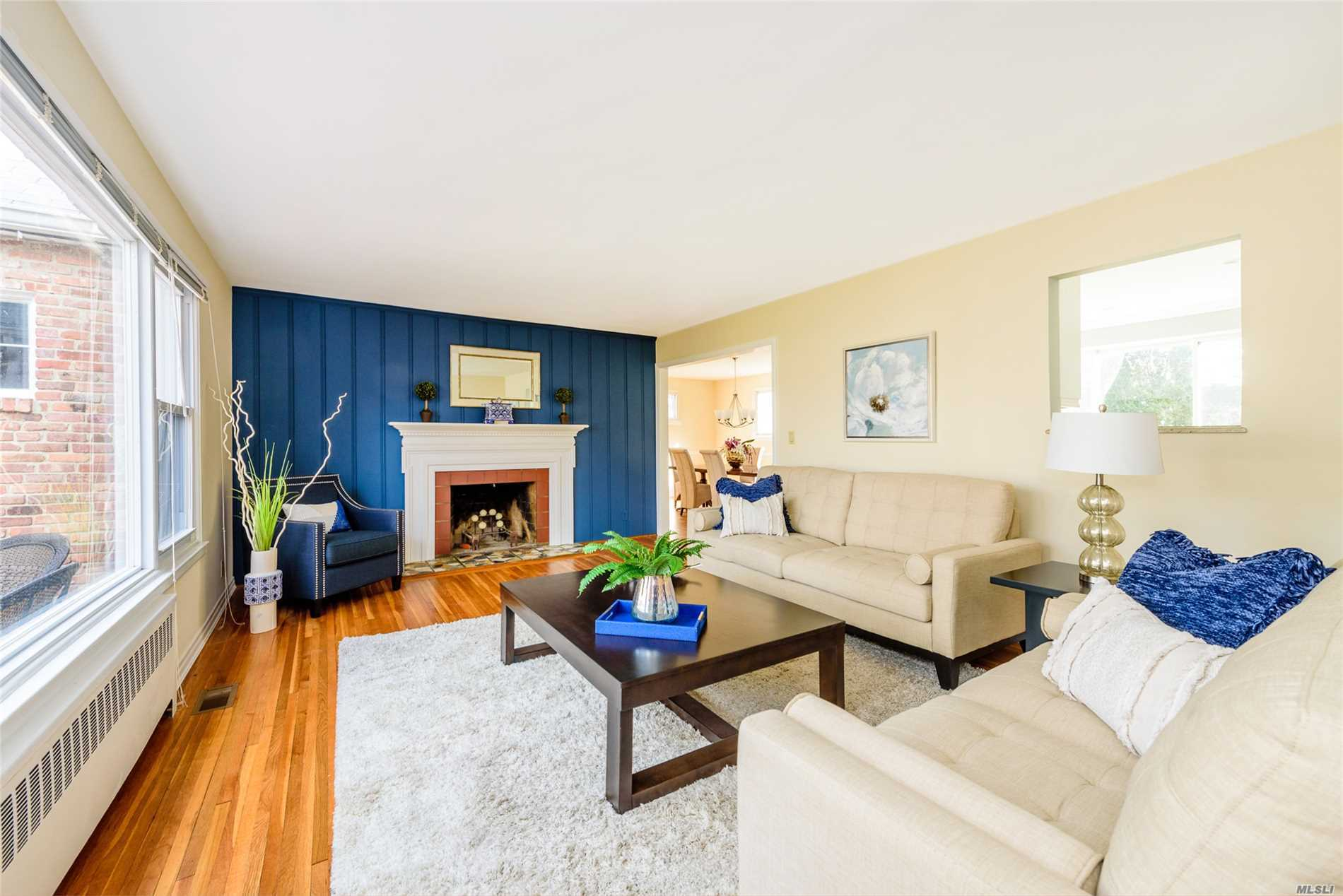 Bright, Spacious Home On Prime Mid-Block Location In Baxter Estates On A Flat Oversized Property! 4 Bedrm, 3 Bath, Features Newly Updated Eik And Bath, Lr W/Fplc, Large Fdr, Hw Floors Throughout, Cac, Igs, Full Basement With Ose. Close To Town & Train.