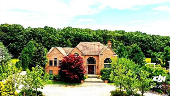 Exquisite Fully Bricked Home On Premium Lot, Gated Com. Desirable HHH SD. Vaulted & Coffered Ceilings W/ Crown Moulding Throughout. 6 Zns For Heat And A/C. Radiant Heat W/4 Zns. Ellliptical Sliders & French Doors. Sub Zero & Thermador Apls,  Wet Bar & Light Schemes. Grand Master Br W/BreathTaking Views of It's Parklike Grounds. Exp Mstr Bth. 400 Amp Electric, 2 Hw Htrs/190 Gal.FR Drain, 2nd Fl Lndry Salt Water Pool W/Jacuzzi & Waterfalls. Huge Basement W/10 FT Ceiling. NO EXPENSES SPARED!