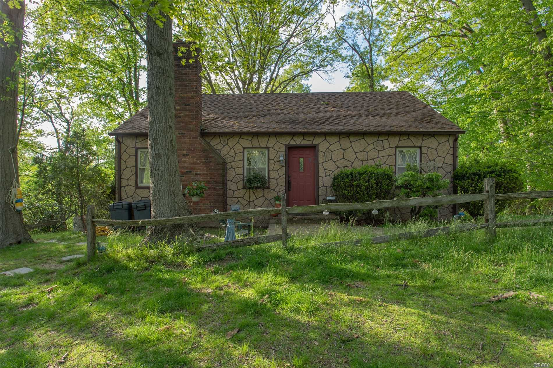 Charming Cape! Located On A Half Acre Adjoining Private Park & Fresh Water Lake. Long Island Sound Views, Private Beach Association, Low Taxes. A Must See!