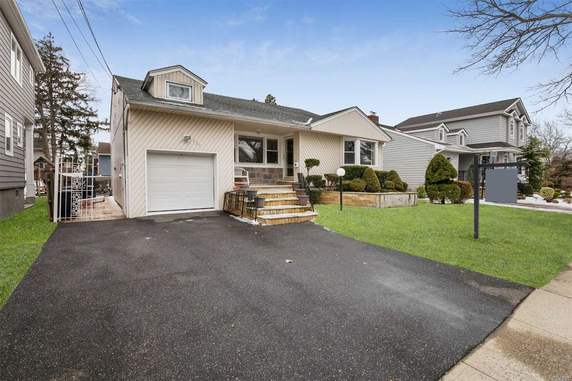 Spacious Split Located In The Heart Of Woodmere. Eat In Kitchen, Formal Dining Room Opens To Living Room. Den With Fireplace, Inground Gunite Pool, Swing Set, Master Bedroom With Full Bath And Walk In Closet, Hardwood Floors Upstairs, Cac, 3 Zone Heat With Separate Hot Water Heater. Close To Houses Of Worship.