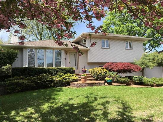 Beautifully Maintained Split On A Very Private Quiet Street. New Roof ( 6 Years), Updated Windows, Pella Slider In Kitchen Leads To Two Tiered Deck, Corian Countertops In Kitchen, House Alarmed, Extended Den, 1.5 Car Garage. Cac, Igs. Gas Line In Street!! Low Taxes! $8773.64 With Star Reduction.