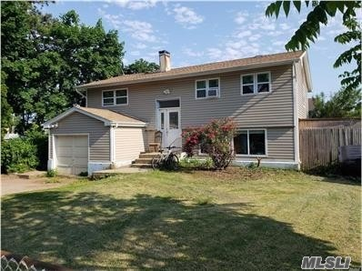 High Ranch With Plenty Of Potential... Perfect For A Large Family!