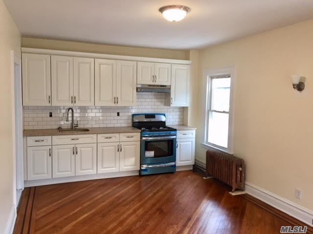 Extra Large 4 Bedroom/2 Bath Duplex Apartment In Private House. Completely Renovated, Beautiful Kitchen And Bathrooms. Plenty Of Closet Space, Walk In Storage Room. Property Situated In The Heart Of Kew Gardens, Within Just A Short Walking Distance To All Shopping, Transportation, Express Trains E And F And Lirr. Call Today