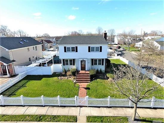 Tastefully Done, Renovated Center Hall Colonial On Large 80 X 100 Property, 3/4 Bedrooms, 2 Beautiful Brand New Baths. Formal Living Room W/Gas Fireplace! Eat-In-Kitchen W/High End Line Stainless Steel Appliances & Cabinets, Granite Counter Tops & Breakfast Bar. Formal Dining Room, Master Suite W/Dressing Room, Arched Doorways, Hardwood Floors, Custom Closets, Detached 2-Car Garage/Cabana, Sun-Drenched Backyard W/16X32 Ig Vinyl Pool & Trex Decking! Half Finished Basement, Great For Entertaining!