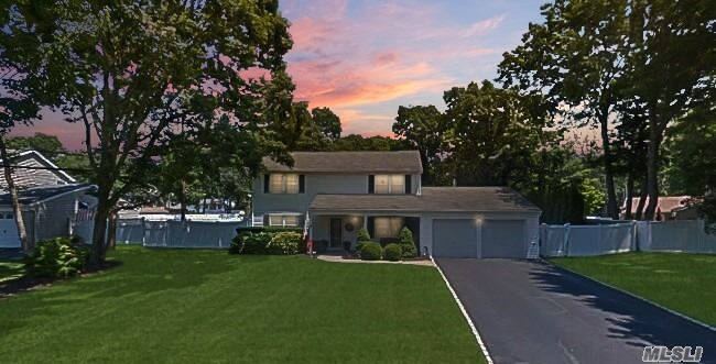 MINT SMART HOME COLONIAL: 4 BR 2.5 Bath, Updated Kit Granite/SS. Walk-in Pantry LR with custom fpl and bar. Den/Media Rm 70 Surround Sound Theater, Formal Dining Rm. Large EIK Util Rm. 2 Car Gar w/attic CAC, New Gas Burner STAYCATION RESORT-LIKE YARD IG heated pool, waterfall, paver patio, covered porch, outside bar/kit, TV & Audio  Smart Features Include: All Lights, Thermostat, Security incl/ Int/Ext Cameras Controlled By Cell/Alexa. Three Village Schools This Will Not Last!