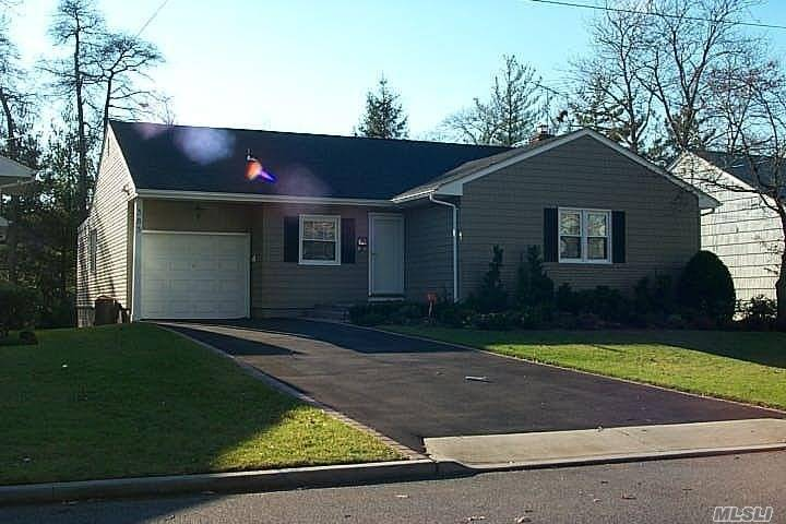 Ranch With Full Finished Basement (High Ceiling), Best Location, Oil Heat But Gas Cooking, Over Sized Property With Large Deck And Electric Awning.