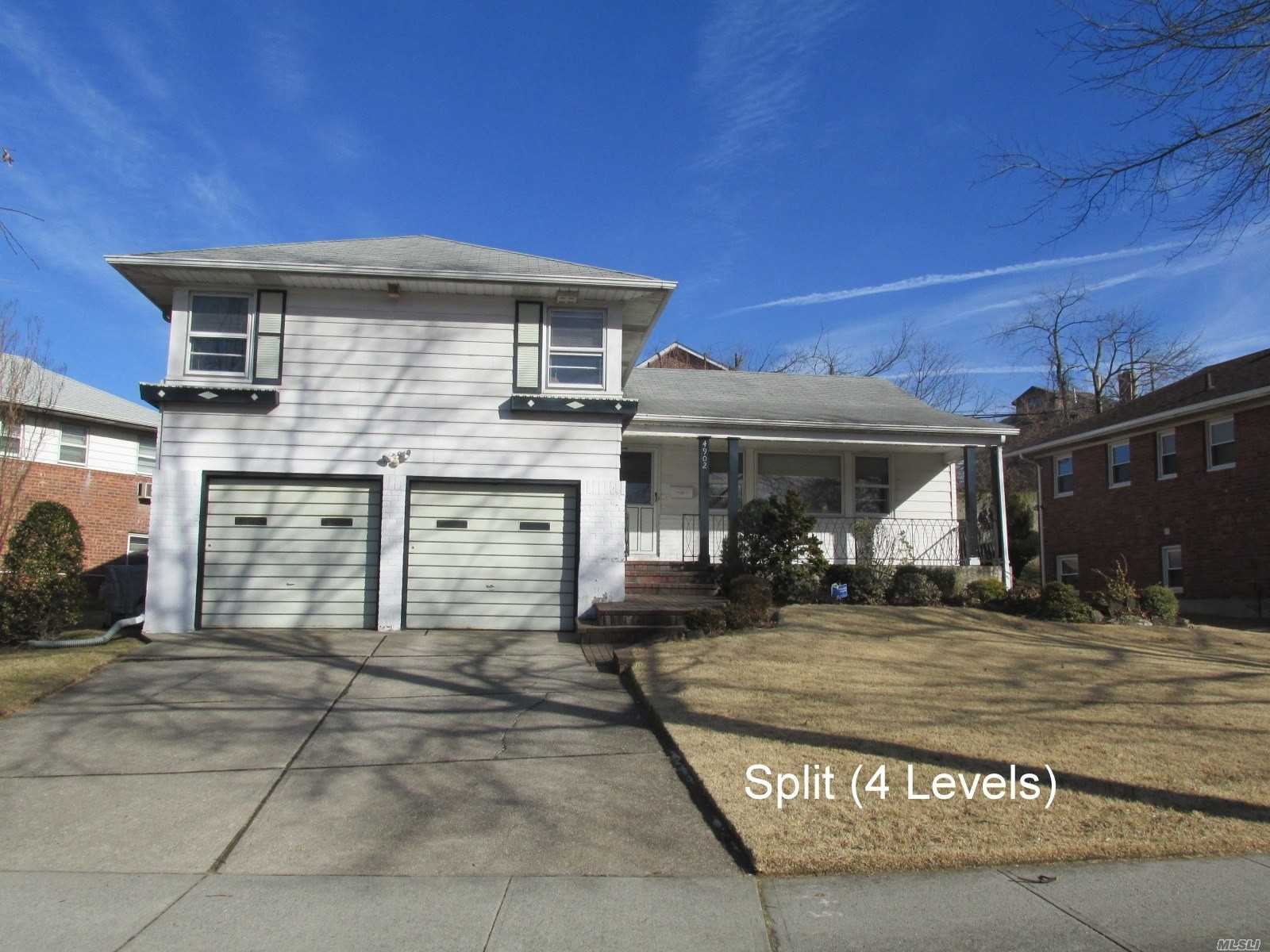 Huge Four Level Split On Over Sized Lot; One Block From Oakland Lake; Hardwood Floors Throughout; Attached Two Car Garage Plus Family Room; Brick Fireplace Plus Finished Basement; Three Bedrooms/Two Full Baths.