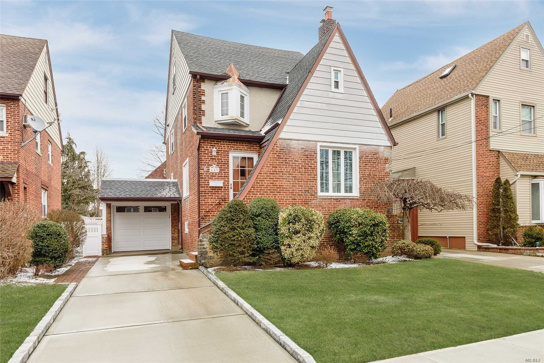 Charming Gibson Brick Tudor With Wood Burning Fireplace, Original Oak Floors Thru Out, Updated Kitchen And Baths. Full Walk Up Attic, Walk In Closet In Master Bedroom, Cac, Igs, New Roof, New Heating System, New Hwh, New Pvc Fence, New Driveway With Belgium Blocks. Seconds To Lirr, Shops, Park And Bus.