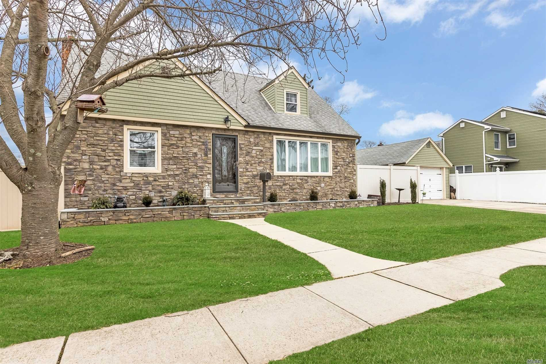 Beautifully Updated And Maintained Home Offers 3 Huge Bedrooms, New Bath, New Siding With Stone, Pvc Fencing, Updated Kitchen, Roof And Gas Heating System Within 6 Years, Beautiful Hardwood Floors, Full Finished Basement With Outside Entrance. All Nestled On A Quiet Block. Seaford Schools! Won't Last!