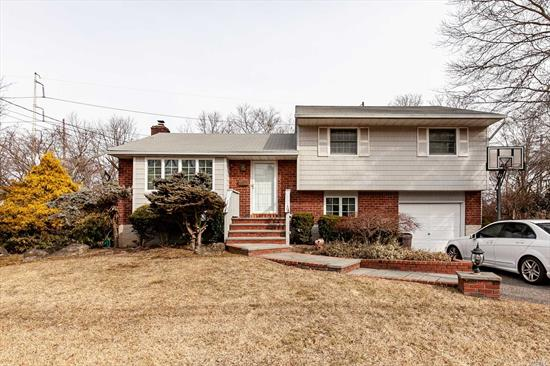Lovely, Well-Maintained Split Level Home Just Minutes To Town And Railroad Station. This Home Features 3 Br's, 1.5 Baths, Wood Floors, Formal Dr, Den & Finished Basement. Deep Backyard With Large Deck, Cac, & 1-Car Garage Complete This Home.  Village Elementary, South Woods Middle School. A Must See!