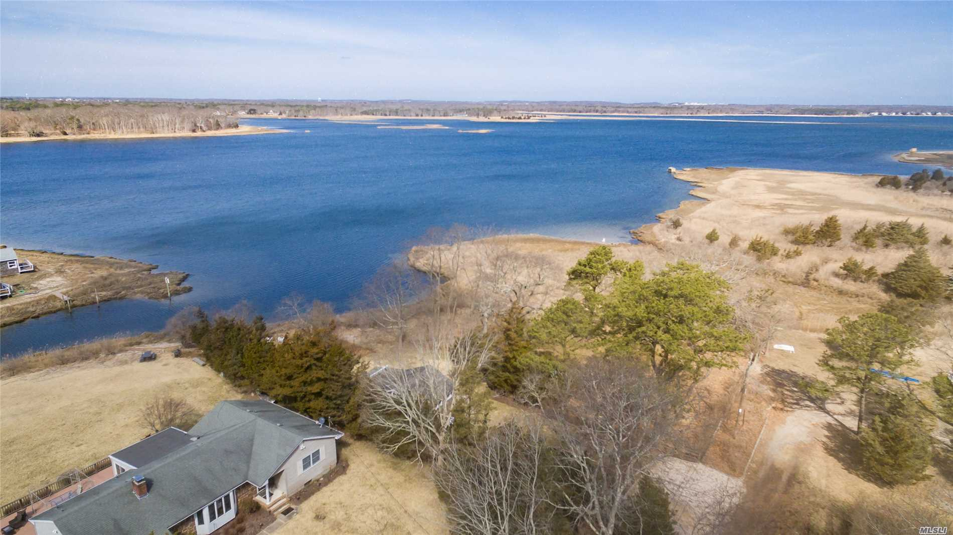 Waterfront Jewe This Waterfront Jewel Has Commanding Panoramic Views, Deeded Dock Rights, Two Kayaks. The Tiered Blue Stone Deck Is 330 Square Feet With Wrought Iron And Ceramic Planters (Incl) As Well As A Second 144 Sq Foot Brick Patio For Sunset Viewing.