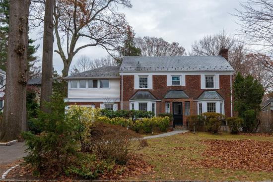 Gorgeous, Bright, Renovated Brick Center Hall Colonial! This Home Features A Lovely Living Room With Fireplace, Bedroom, 1.5 Baths, Den On First Floor. Upstairs You Have 4 Bedrooms, 2 Baths, Plus Attic. A Must See!