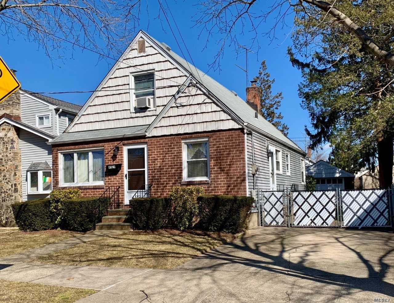 This Cape House Is Well Maintained And In Move In Condition. 4 Bedrooms, 1 Bath Room Hardwood Floors, Full Basement, Detached Garage. The Property Size Is 49 X 100 X 37 X 101 = 4, 300 Sq.Ft. Public Transportation Including The Lirr, Shopping And Recreation Are Within Walking Distance.