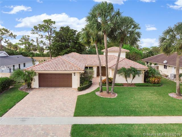 Beautiful Estate Home In The Establish Community Of Wind Drift In Boca Raton! This Home Has 5 Bedrooms With A Triple Split Floorplan Including A Master Bedroom Upstairs And A Master Bedroom Downstairs, 3 Full Baths, Formal Dinning Room, Large Living Room, Additional Game Room/Bar, And Crown Molding Throughout, Plantation Shutters, Faux Wood Blinds, Real Wood Flooring In Bedrooms And Stairs, Tile Throughout Living Areas. Large Screened In Pool And Patio Area Great For Entertaining, Overlooking Huge Fenced In Backyard. Home Also Includes Hurricane Impact Windows, Hurricane Accordion Shutters For Doors, Generator Hook Up, And So Much More!! Low Hoa! This Is A Must See!