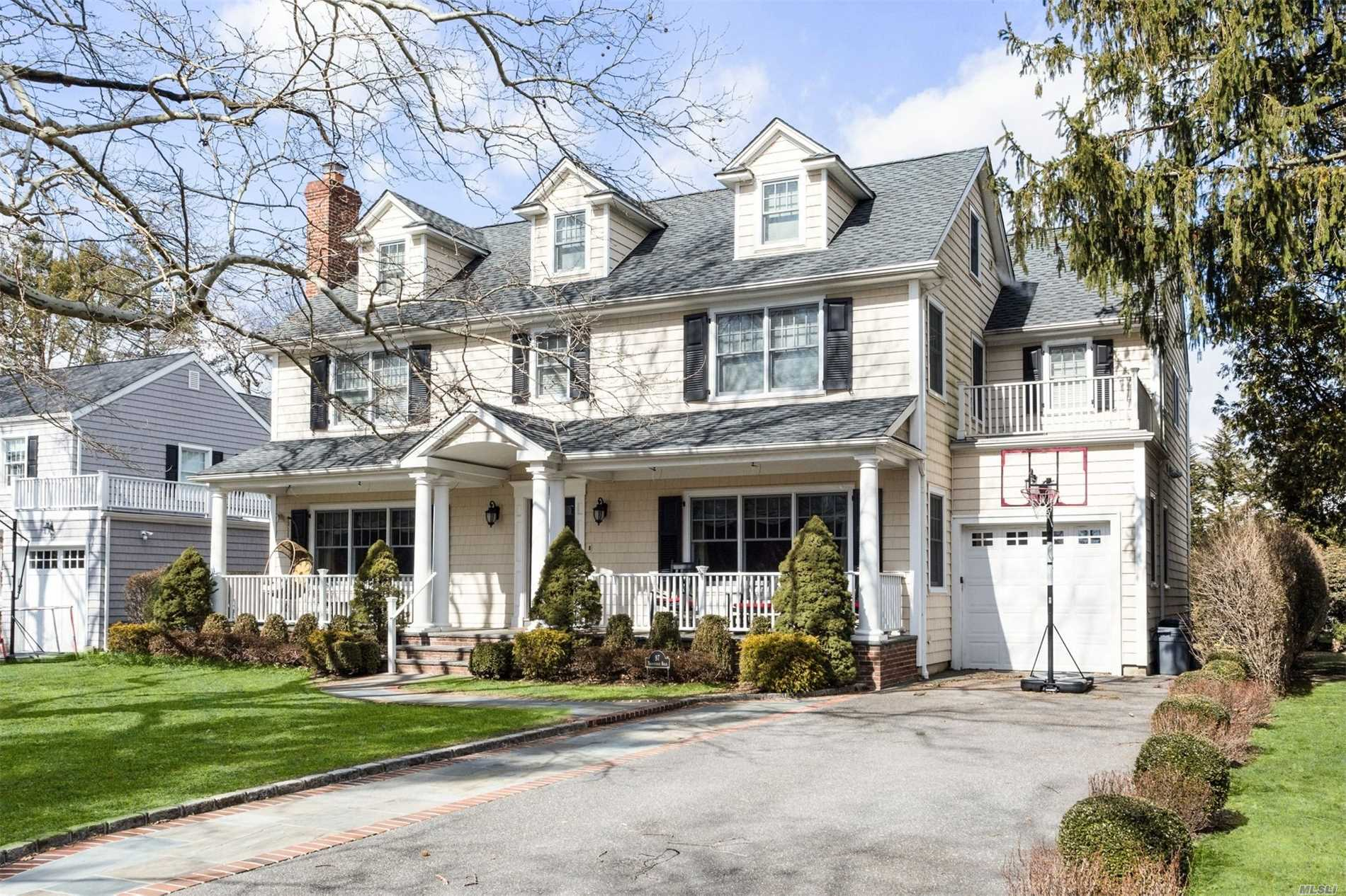 Built Brand New In 2008 By Old World Corp On Deep Lot In Mott Section. Timeless Appeal Of C/H Colonial W/Perfect Layout Features Lr W/Gas Fp, Fdr, Mud & Gourmet Kit W/Impressive Island Completely Open To Dining Area & Fam Rm. Second Flr Boasts Mbr W/Wic & Marble Bath, 3 Large Brs Serviced By 2 Full Baths & Laundry. Spacious Walk Up Attic, Bsmt Game Rm, Rec Rm, Gym, Office & Bath. 4 Zone Geothermal Heat & Cac. The Location, Design & Superior Craftsmanship Make This The Perfect Place To Call Home!