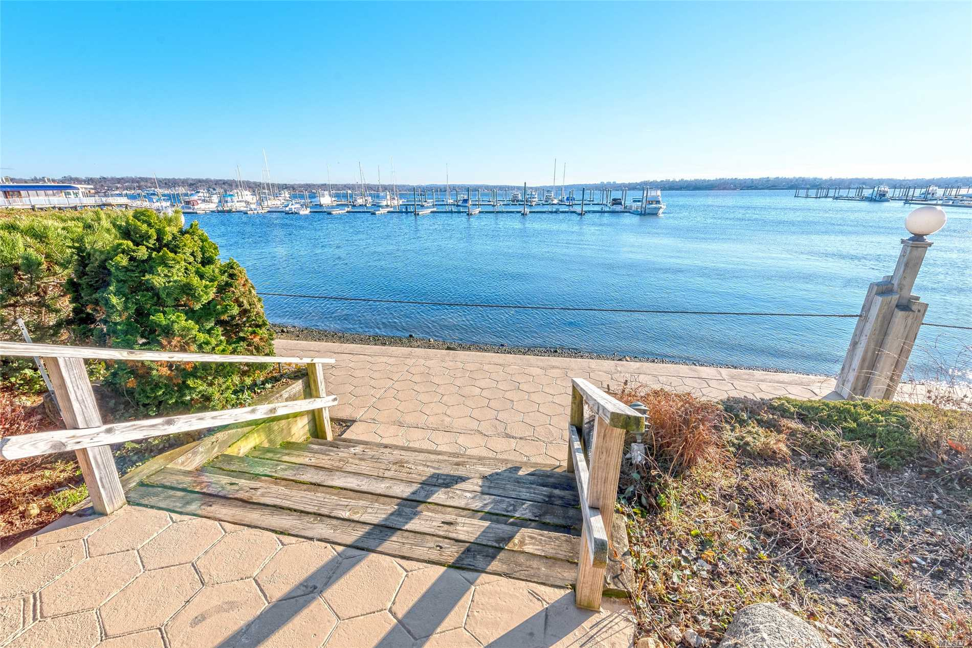 Jaw Dropping Views Of Manhasset Bay From This Turn Key, 3/4 Bedroom Townhouse, Recently Renovated From Top To Bottom, Inside And Out. Spectacular Water Views From All Three Levels. New Roof, Siding, Decking, Hw Floors, 3.5 Baths, Kitchen & More! Vacation 365 Days A Year. Annual Maintenance $4000 (Snow Removal, Gardening And Water)