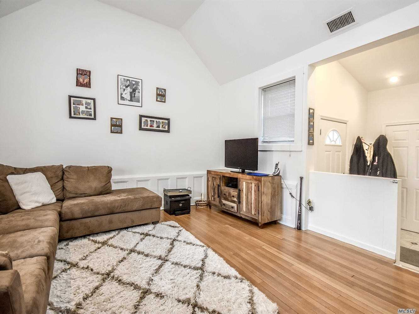 Utilities Included. Wood Burning Fireplace. Brand New Stove, Refrigerator, Washer And Dryer. New Deck. Huge Kitchen. All Hardwood Floors.Central Air. Outdoor Parking For 2 Cars. Absolutely No Pets.