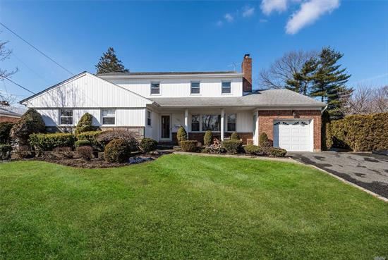 A Large 6 Bedroom, One Of A Kind Colonial In The East Meadow Schools District, 4 Full Bath, Large Livingroom W/Fireplace, Dining Room, Large Den, Large Kitchen, Hardwood Floors, Central Air, New Windows, Large Basement With Utility Room, Mid Block, One Of A Kind !!!!!!!